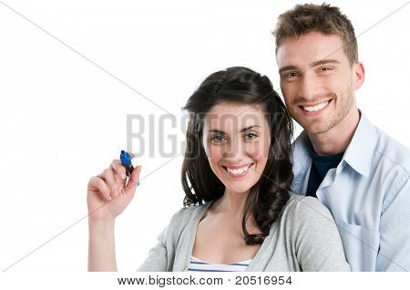 Loving smiling young couple write with marker your text isolated on white background