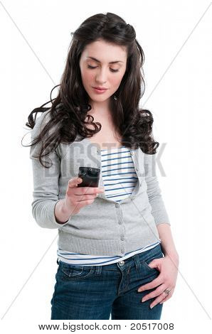 Smiling beautiful lady text messaging and chatting with her smart phone isolated on white background