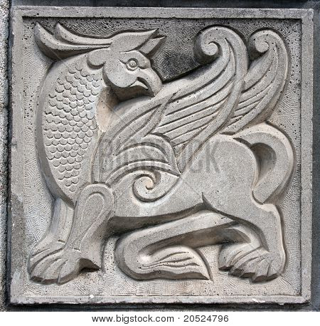Old Bas-relief Of Fairytale Winged Lion