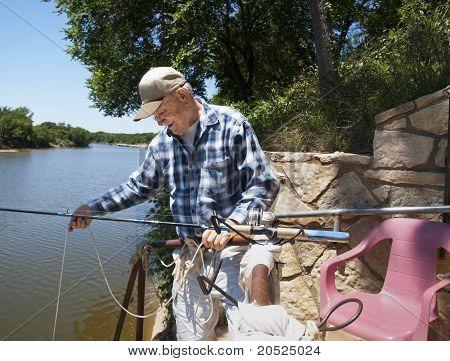 Elderly Man Lowering the rope