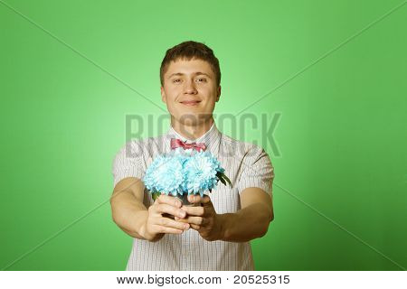 """Lover man """"nerd"""" with a bouquet of flowers"""