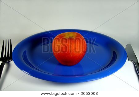 Apple On A Blue Plate