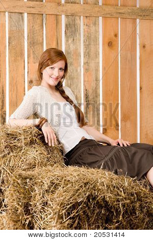 Romantic Young Woman Sitting On Bales Relax