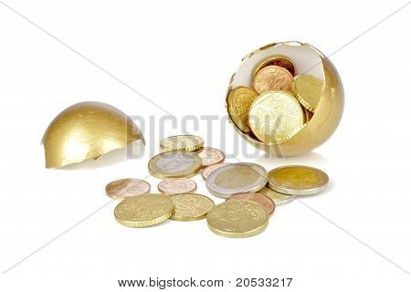 Broken golden egg with euro coins