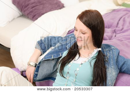 Young Happy Student Relax Leaning Over Bed