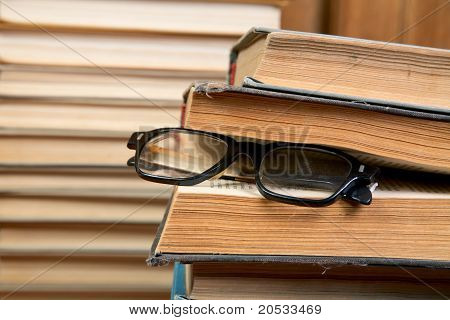 Pile Of Books And Old Glasses