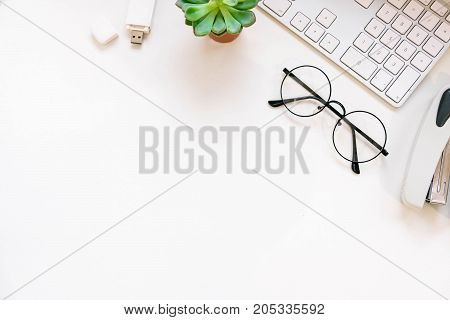poster of Modern White Office Desk Table With Laptop Computer, Stylish Tablet With Black Screen Over. Minimal