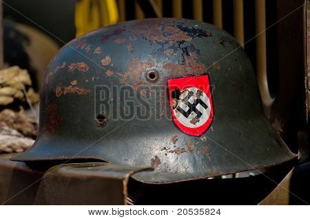 Nazi Helmet On American Jeep