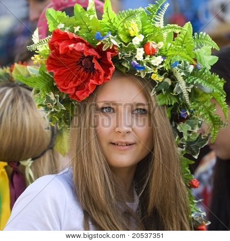 Kiev, Ukraine -29 May: Day Of Kyiv. A Girl Wearing A Crown Of Flowers Walking Down The Street. May 2