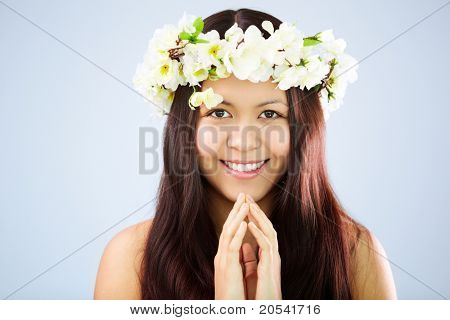 Image of happy female wearing floral wreath on head