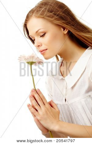 Image of fresh female holding nice herbera and smelling it