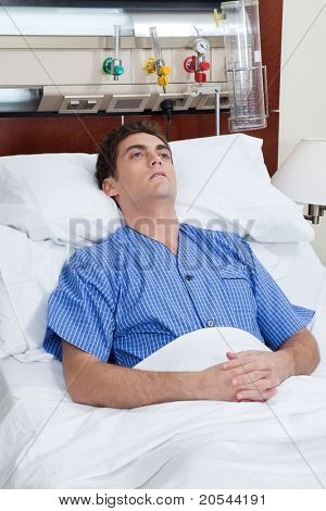 An severe male patient at hospital bed