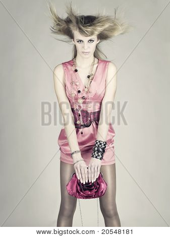 Refined young lady loves her bag. Fashion photo