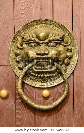Bronze gate knocker in old chinese style.