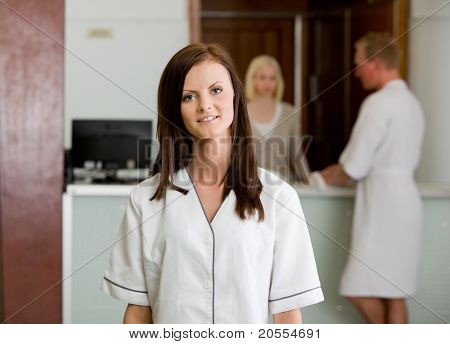 Portrait of a spa therapist in a reception interior