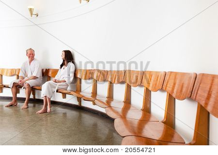 A man and woman in a retro style spa reception