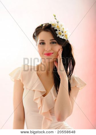 Beautiful Fresh Summer Woman With Flowers In Her Hair And Pure Skin