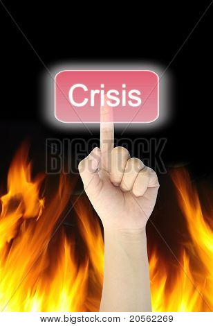 hand pressing crisis button on fire background