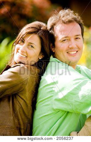 Happy Couple Portrait - Back To Back