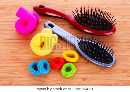 Hair Brush and hair scrunchies on brown background