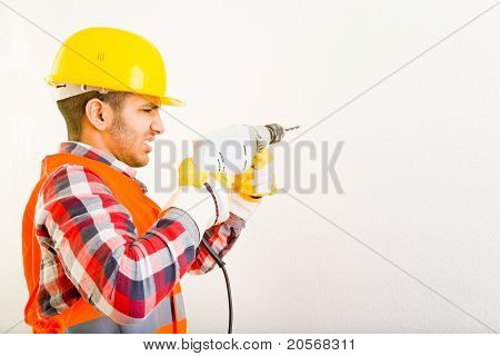 Construction Worker Drilling A Hole
