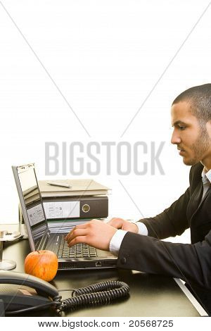 Business Man Typing On His Laptop