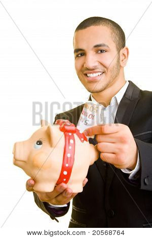 Business Man Putting Euro Banknotes In Piggy Bank