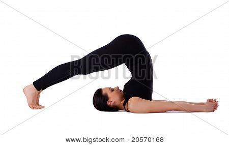 woman exercise yoga pose - halasana isolated