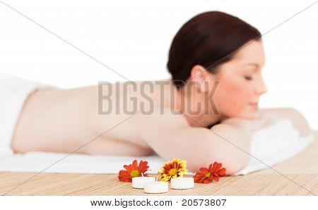 Young Good Looking Red-haired Female Relaxing In A Spa Centre