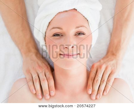 Closeup Of A Cute Red-haired Woman Receiving A Massage In A Spa Centre