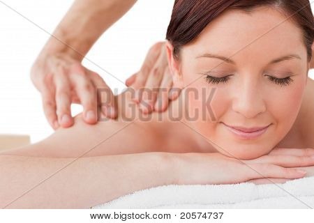 Portrait Of A Serene Female Posing While Receiving A Massage
