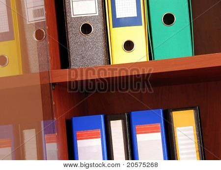 Colorful Files In Office Shelf