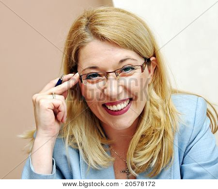 Businesswoman In Glasses Smiling