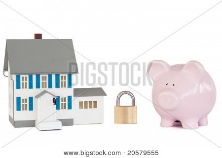 House Locked With Padlock And Pink Piggy Bank