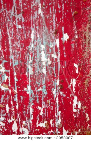 Close Up Of Red Flaking Paint On A Boat Hull.