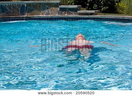 Senior Retired Man Swimming In Pool