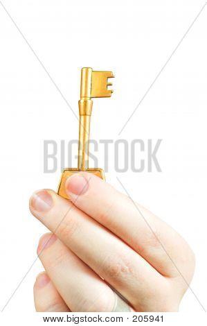 Hand Holding A Key Of Success