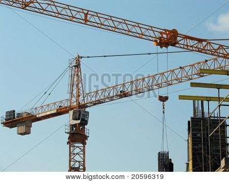 Lifting cranes over frame-house