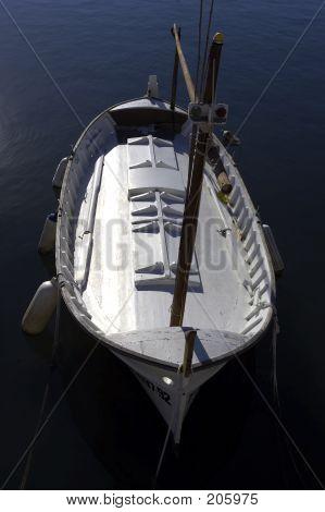 Single Wooden White Fishing Boat