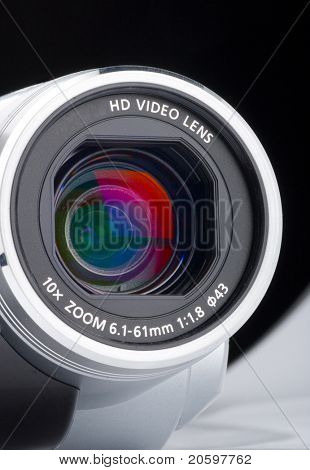 Close-up shot of video camera lens. Isolated on black.