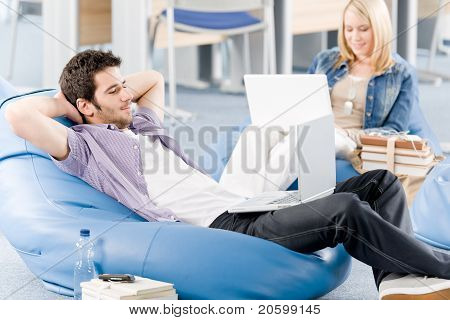Young Students At High-school Relaxing With Laptop