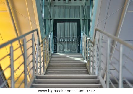 the metal stairs and a glass door