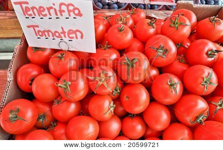 the teneriffa red tomatoes in a paper box
