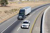 stock photo of 18 wheeler  - Long haul eighteen wheelers depend upon a well maintained infrastructure and interstate highway system - JPG