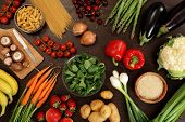 stock photo of healthy food  - Photo of a table top full of fresh vegetables fruit and other healthy foods - JPG