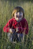 Little Girl Laughing In The Grass
