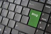 image of backspace  - A close up to a laptop keyboard which has a green blog key - JPG