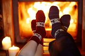 Man And Woman In Warm Socks Near Fireplace poster