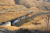foto of bnsf  - Diesel electric locomotives drag their train up Tehachapi Mountain California - JPG