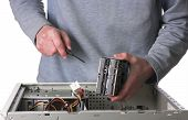 foto of computer technology  - Computer technician installing hard disk drives into PC - JPG
